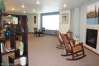 Prairie Trail Residences - Second Level Clubroom with Fireplace and Rocking Chairs