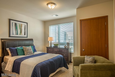 Veritas Village - Carpeted Bedrooms