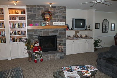 Liberty Square Senior living - Library and Gathering Room with Television